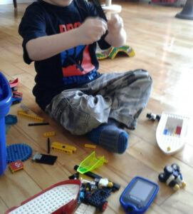 8 Tips on Parenting a T1D Child - kid playing with toys