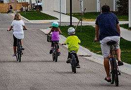 Is Bicycling Good Exercise - dad and kids riding bikes
