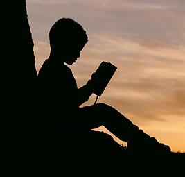 Tips to Raising Happy Kids - Child reading