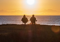 What is Passive Income Streams - couple sitting in sunset
